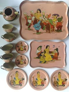 "Vintage Ohio Art pink  tin litho toy tea set with Walt Disney's  ""Snow White and the Seven Dwarfs"" design."