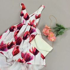 This stunning red and pink dress is so perfect for the warm, spring season! A watercolor design adds elegance and style to a classic dress.
