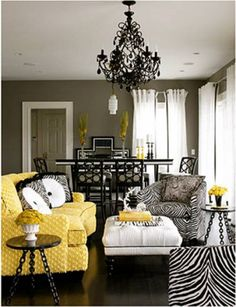 Yellow, black & white is a dramatic color combination. It wouldn't be for me, but it's well done here. I like the warm grey walls that help pull it together. I still feel like black chandeliers belong in a haunted house though.
