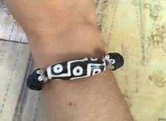 A personal favorite from my Etsy shop https://www.etsy.com/listing/463275381/mystical-good-luck-bracelet-9-eye-dzi