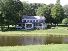 PERFECTION.   A beautiful farm house with lots of tree's, lots of green grass.....and it's own pond.  <3