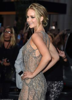 Looking good: Its form fitting design drew further attention to the actress's slender physique as she posed for photos