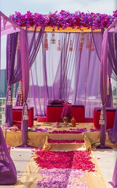 A romantic pink and purple mandap setup for an Indian wedding ceremony. -repinned from LA County, California officiant https://OfficiantGuy.com #weddingofficiant #losangelesweddings