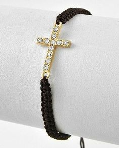 Inspirational Brown Leather Pull Bracelet with Cross Abernook. $15.00. A fun and inspirational gift to give for a special occasion, celebration or as a reminder of your faith.. A great confirmation gift, graduation gift, religious occasion or holiday gift idea.. Brown leather with a gold toned crystal cross - trendy and fashionable design.
