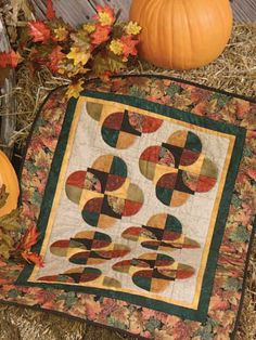 """Fall Flourish: FREE download....by Connie Kauffman Make a splash of autumn color to display in your home with this free quilting pattern. Finished Quilt Size: 22"""" x 32"""".  Skill Level: Intermediate"""