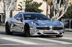 Chrome Fisker Karma, Fisker Automotive (Electric Car ... Green Luxury Car).  Justin Bieber owns this one.