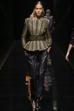 "Balmain ""The utility trend offered something for everyone, from simple wool pants at Isabel Marant to luxuriously crafted leathers at Balmain"" Vogue contributing fashion editor Bay Garnett. Khaki, forest greens, tans and mustard - this season, designers interpreted military touches in the classic camouflage palette"
