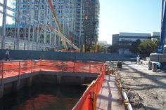 setting large overhead crane at indoor boat storage facility on 17th St. Causeway in Fort Lauderdale