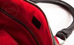 Fire red leather with black leather elements. Red fabric inside