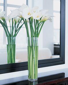 calla lillies in a fourteen-inch glass vase. simple but beautiful. #martha stewart weddings