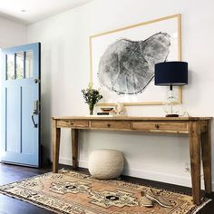 Over dyed rug wood console table entryway | Banner Day