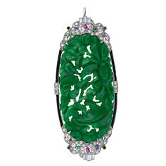 Art Deco Carved Jade Art Deco Pin / Pendant. This high Art Deco treasure dates back to 1925, the apex of fine jewelry craftsmanship. A hand carved oval jadeite plaque is presented in an exotically designed platinum frame with insets of black enamel and tiny cabochon rubies, sapphires, emeralds and onyx. A retractable bale allows it to be worn as a pendant. A superb and beautiful jewel for a connoisseur. $18,750.00.