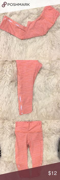 """aerie Capri yoga pants with leg detail Peach, pink, and white in a sort of heathered pattern on these fun yoga capris. They have a cute open design on the sides of the calf, toward the bottom. Barely worn, excellent condition. Super soft! Inseam 20 1/2"""". Waist 13"""" laying flat. Non-smoking home. aerie Pants Capris"""