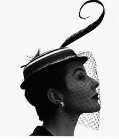 the feather, the veil, the earing, the Mary Poppins hat - delicious!