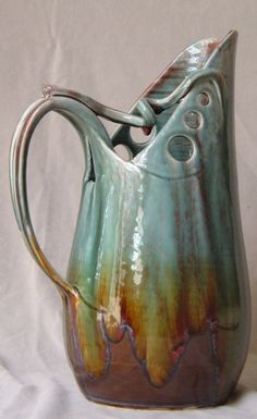 I like the way he made a pitcher with the holes at the top