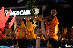 Buddhists off all ages giving blessings at the Wesak Day (Vesak Day) parade in Kuala Lumpur, Malaysia.