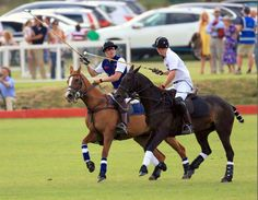 Prince William and Prince Harry played on opposite teams for the June Goldin Group Charity Cup at the Beaufort Polo Club in Tetbury, Gloucestershire.  22 June 2014