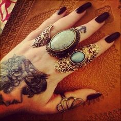 Rings. i love everything about this pic, the long dark nails, the jewelry, the tattoos! ahh