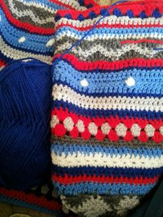 Mixed stitch crochet blanket in 'boys colours'