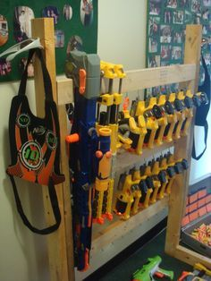 Nerf Gun Rack- Ready for a fair battle with a bunch of guys. This is sweet.
