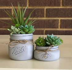 Give any room in your home or office a beautiful touch with this charming artificial succulent mason jar decor. These painted mason jars are the perfect addition to any space. Keep this succulent planter for years worry free. It makes the perfect gift for Mason Jar Succulents, Faux Succulents, Succulent Planters, Plants In Mason Jars, Succulents Garden, Hanging Planters, Cheap Planters, Tall Planters, Small Mason Jars