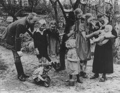 "Nazi policy encouraged racially ""acceptable"" couples to have as many children as possible. Because of the number of children in this Nazi party official's family, the mother earned the ""Mother's Cross."" Germany, date uncertain.  — DIZ Muenchen GMBH, Sueddeutscher Verlag Bilderdienst"
