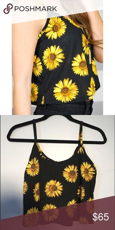 Black Sunflower Tank Adorable black tank top with spaghetti straps featuring a beautiful sunflower print! Second pic does not do it justice! Good used condition! Note: there are slight remnants of a name label left on the inside near the tag but not noticeable when worn at all! LF Tops Tank Tops