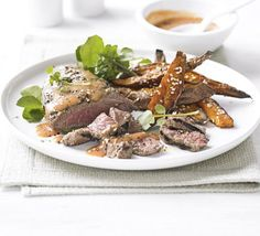 Try this Asian twist on steak and chips - serve griddled beef with a chilli miso baste and sesame-flecked sweet potatoes