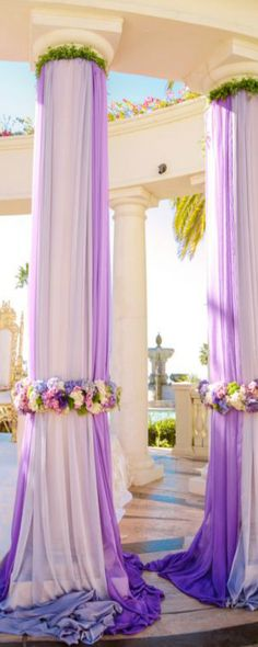 this could be cool to do with the poles at CCV with lilac draping and flowers