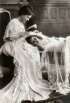 1900's Mother reading to daughter