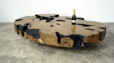 Coffee table / contemporary / petrified wood / indoor OVALE JÉRÔME-ABEL SEGUIN