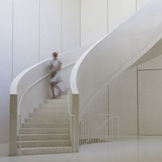 Berger & Berger uses white concrete and marble to create muted interiors for Collection Lambert. See more examples of white concrete on dezeen.com