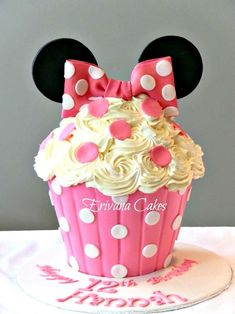 Minnie Mouse Birthday Party Ideas Minnie Mouse cupcake cake photo booth photo props decorations Minnie Mouse water labels