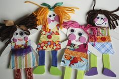 4 paper dolls made from cardboard and fabric scraps