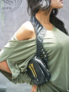 "This ""Ahni Gear"" shoulder holster by Resonating Threads is not the purse of your mother's generation.  In our dynamic world we need our technology close at hand.  With this shoulder pouch, your mobile technology is available to help you command your world while looking like a Boss.  The main body in each pouch fits a smart phone and wallet and passport. Room for keys, business cards, coins, and secrets in the 4 extra smaller zipper pockets for burning man and everywhere else."