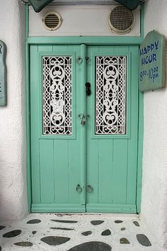 Mykonos sea foam green door with window detail