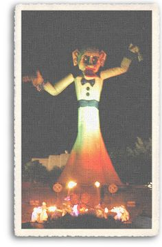 Zozobra is about to start, as the Fire Dancers gather at the base of the 50-foot effigy. The Zozobra event takes places every September in Santa Fe, New Mexico.  Placed a bet with coworkers on year when I worked at the hospital in Santa Fe as to how long it takes to burn down - of course I lost.
