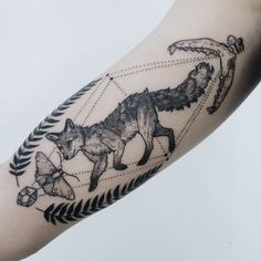 Tiny running fox with ferns, crystal, moth, jawbones, and mushrooms on inner bicep by Pony Reinhardt at Tenderfoot Studio in Portland, OR.