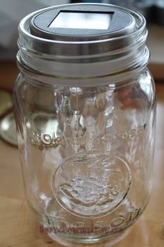 KR Notes: I like the idea of using the double sided tape to hold the solar light in the jar. Mason Jar Solar Lights, Solar Fairy Lights, Mason Jar Lanterns, Solar Lanterns, Mason Jar Lighting, Jar Lights, Mason Jar Art, Pot Mason Diy, Mason Jar Crafts