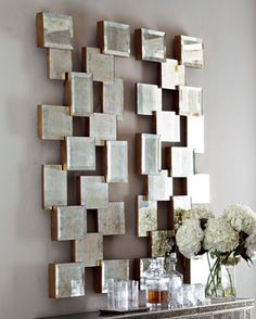 mirrored wall decor...easy....mirrored squares on silver painted wooden mounts...alot of texture....