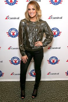 Carrie Underwood in a metallic top and black jeans