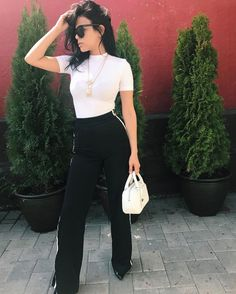 High wasited trousers with a black shirt to minimize the boobage?