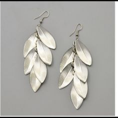 Silver leaf earrings New in packaging. Silver plated earrings. No trades Jewelry Earrings