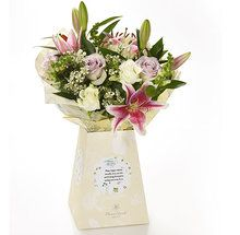 """Add an extra special touch to precious birthdays with this stunning bouquets of pale pink and pretty lilac blooms set among lush green foliage and your own kind wishes. """"Happy Birthday"""" will be printed on the label as well as your personal message."""