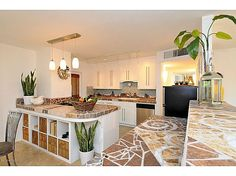Walk through the custom gate and you are greeted by a tranquil fountain in a beautifully landscaped private courtyard. Living room is spacious, open and features an eat up bar perfect for entertaining. Kitchen opens to family room, has artistic mosaic counter tops,stainless steel oven , dishwasher and Dacor range. Den features a stylish mosaic tile and river rock fireplace surround . #zillow