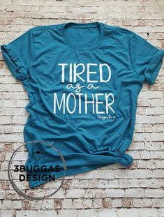 "Tired as a Mother design on our triblend tees!!  You will love wearing your original ""tired as a mother"" design. This hustle shirt is great for wearing to the gym, running errands, and of course for a lazy morning on the couch.  ♥Ladies Scoop Neck Tee♥: ~Preshrunk tri-blend, ladies semi-fitted tee, size up for more relaxed fit ~50% polyester/25%combed ringspun cotton/25%rayon ~Please see listing pictures for sizing details.  ♥Unisex Crew Neck Tee♥: ~Preshrunk tri-blend, ladies usual..."