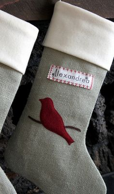 could make these...burlap stockings with soft interiors, stamped name tags and felt decoration