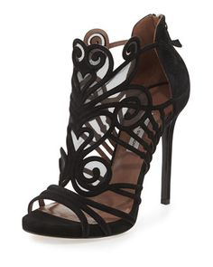 curvaceous straps of this Tabitha Simmons statement sandal.