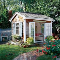 I love the pretty brick walkway in front of this shed