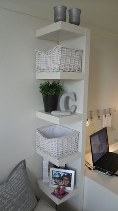 Ikea LACK shelf. Smart idea for use: it's probably attached to the table and at the same time works as kind of a room divider, from living froom to office. I have one of these and need a way to use it without attaching it to the wall.